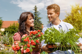Couple Taking Herbs and Flowers to Friends
